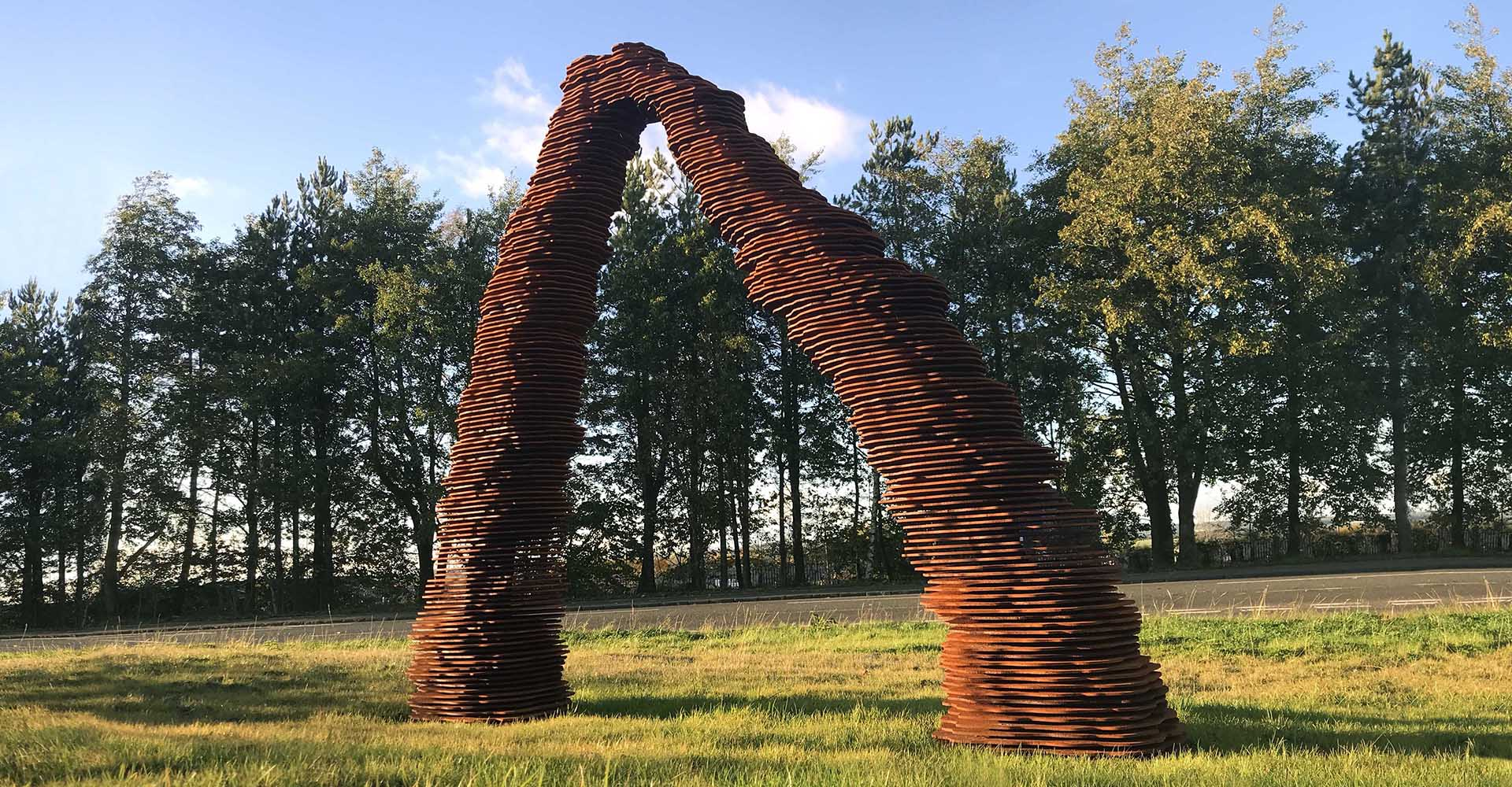 Corten steel gateway arch in West Calder large metal art sculpture by artist Kate Ive