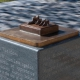 Public Art Commission in Helensburgh showing small bronze show sculpture on a plinth by artist Kate Ive