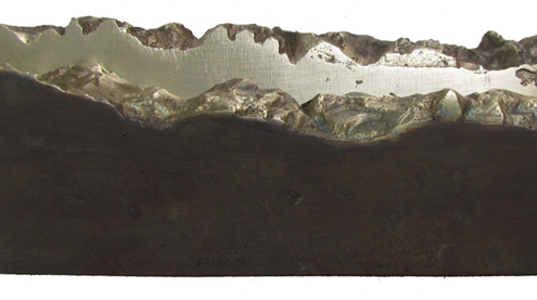 Bronze art medal sculpture inspired by landscape and mountains in light and dark patina