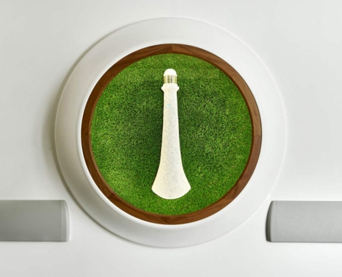 Royal Hospital for Children Artwork, sculpture,White cast jesmonite on a green grass background in a wall mounted cabinet