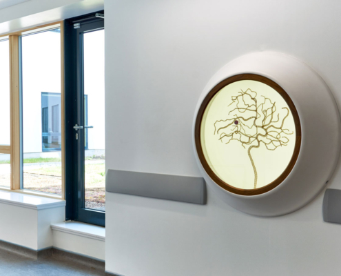 Royal Hospital for Children Artwork, sculpture in a wall mounted cabinet, gold crocheted wire in a brain stent form