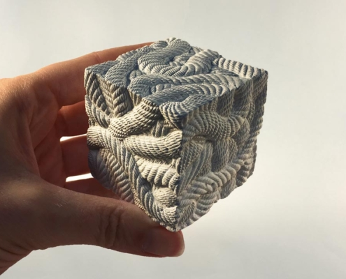 Memory cube hand carved in plaster by artist Kate Ive part of public art sculpture commission for West Calder