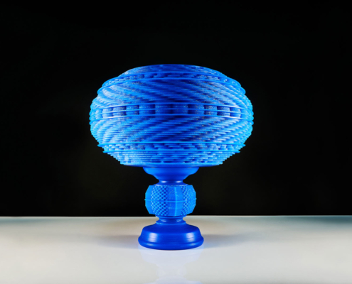 Handmade sculpture by artist Kate Ive made in blue wax carved with intricate geometric guilloche detail